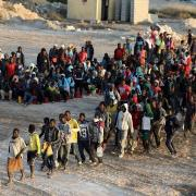 E.U. united on African migration curbs, divided over hosting refugees