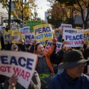 Thousands urge peace in anti-Trump protest in S. Korea